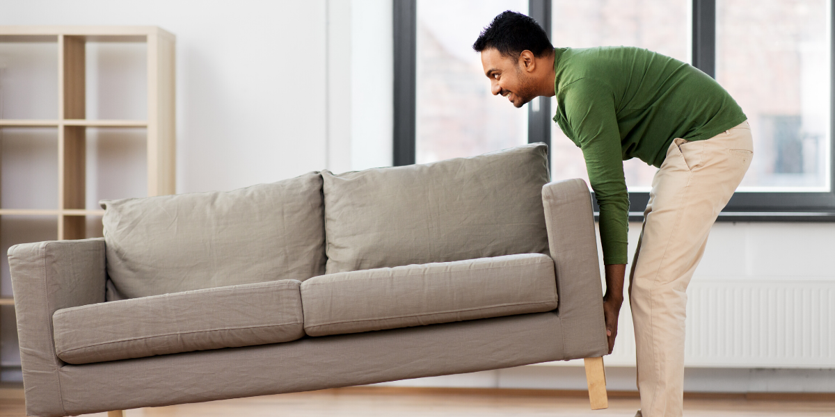 Man moving a sofa